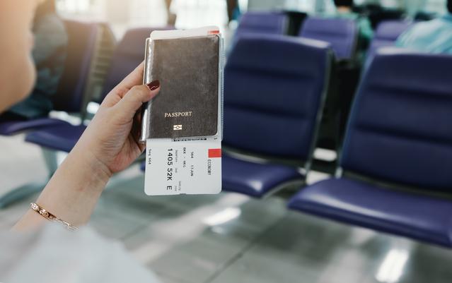 Woman hand holding passport